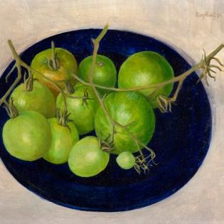 Groene tomaten op een blauw bord