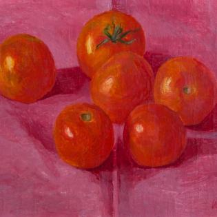 Tomaten op een roze tafelkleed